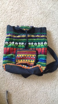 Black green white red and yellow sling bag Baltimore, 21215