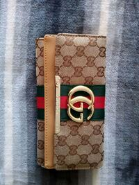 brown and black Gucci leather wallet Ottawa, K1H 5T1