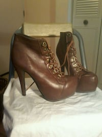 pair of brown leather heeled booties Edmonton, T5B 2W3