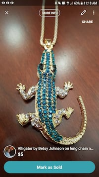 Blue alligator on long necklace by Betsy Johnson Suffolk, 23434