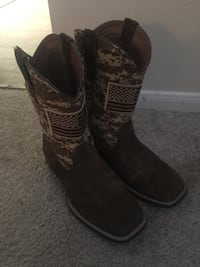 pair of brown leather cowboy boots Houston