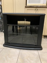 TV stand with glass doors and 3 shelves