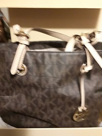 monogrammed brown and white Michael Kors leather tote bag