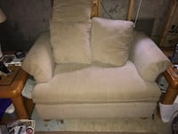 beige fabric cuddle sofa with throw pillows