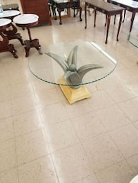 round clear glass-top side table