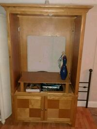 brown wooden TV hutch with flat screen television Conway