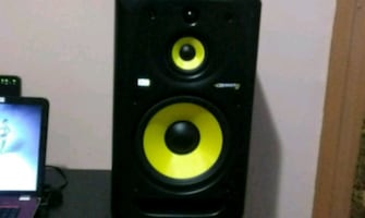 black and yellow subwoofer speaker