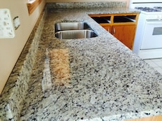 gray and black marble top twin sink kitchen island