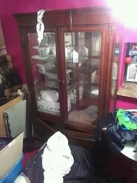 brown wooden framed glass display cabinet Miami, 33147