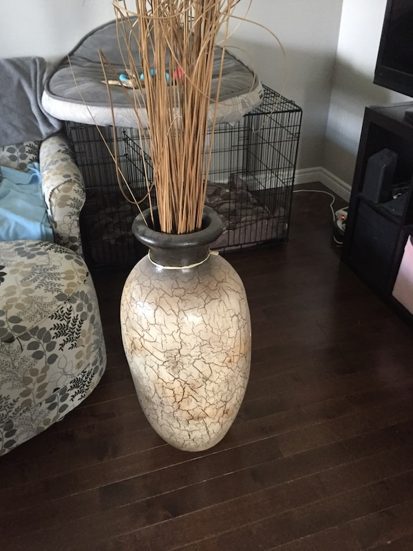 white and brown ceramic vase