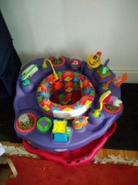 baby's purple and pink exersaucer Ypsilanti, 48198