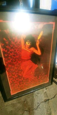 woman in red dress painting Riverside, 92501