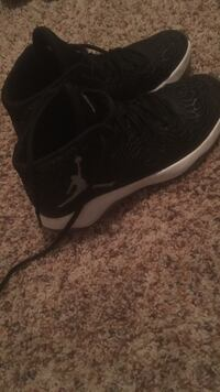 pair of black-and-white Air Jordan basketball shoes