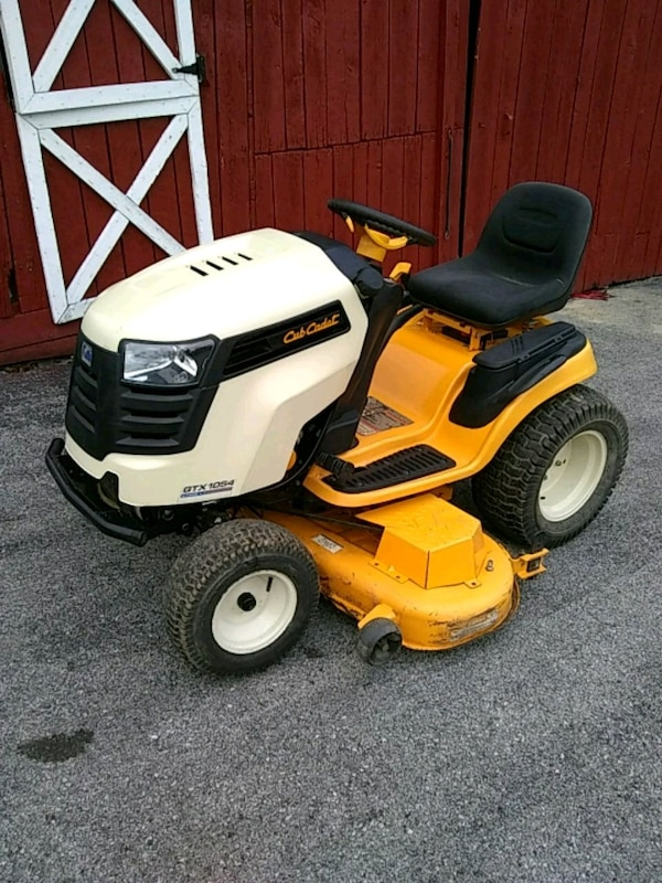 yellow and white Cub Cadet riding mower
