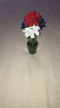 blue, red, and white artificial flowers centerpiece Pomona