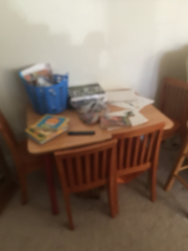 Brown wooden table with 4 chairs