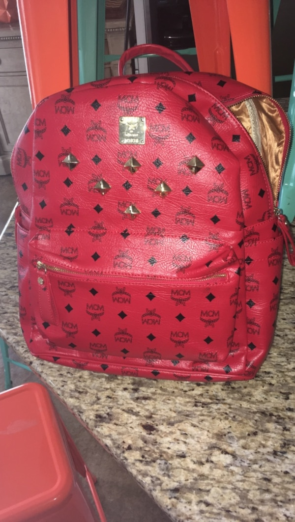 Used red MCM leather backpack for sale in Conway - letgo 507c6de1a79de