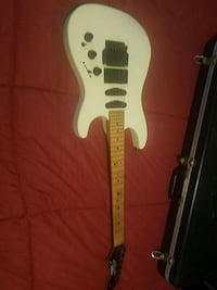white and brown electric guitar Revere, 02151
