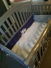 Grey crib includes sheets & bumper pads as shown Perris