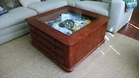 brown wooden framed glass top coffee table 530 mi