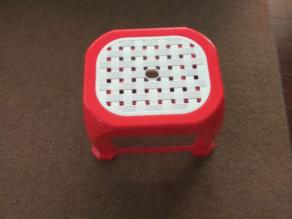 red and white plastic kids stool