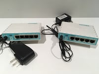 Two white-and-blue modem routers