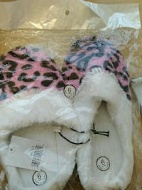 Pink and black slippers
