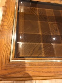 Brown wooden framed glass top coffee table Montréal, H8Z 2C8