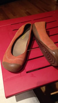 pair of brown suede flat shoes