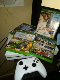 Xbox One console with controller and game cases Baltimore, 21223
