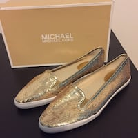 Pair of gold michael kors leather slip-on shoes Laval, H7C 2M3