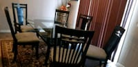Glass top & wooden base dinning table with 6 chairs (pick up Airdrie)  Airdrie