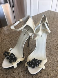 White and black shoes BEBE size 10 2065 mi