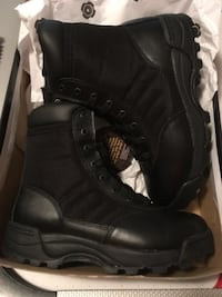 Pair of black tactical boots with box