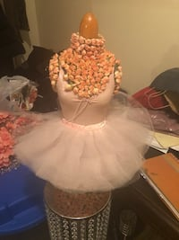 Pink and floral ballerina table stand.  Toronto, M9R 3Z1