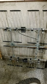 gray and black compound bow 599 km