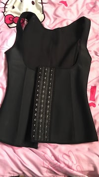 Size-s waist trainer vest, cut off tag before trying on and it's to small for me... never worn  Port Coquitlam, V3B 1L4
