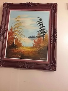pine tree near large body of water painting