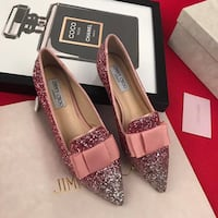 women's pair of silver glittered pumps New York