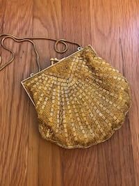 Handmade beaded yellow shell clutch