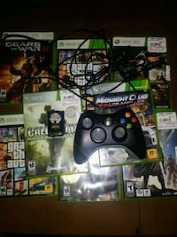 Xbox 360 console with controller and game cases Kaysville, 84037