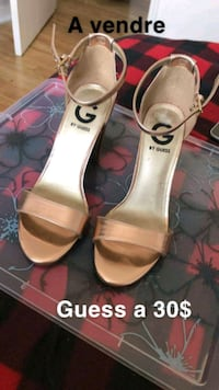 pair of white leather open toe ankle strap heels Laval, H7N 1L3