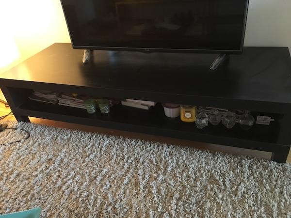 black wooden tv stand