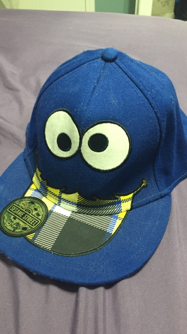 Blue and yellow cookie monster print fitted cap 4228988b-9fea-4880-83dd-184a6f77892e
