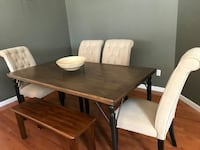 rectangular brown wooden table with four chairs dining set Monmouth Junction, 08852