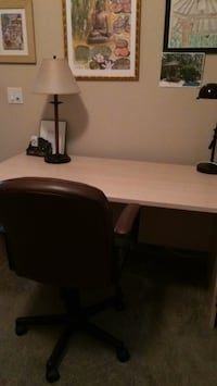 brown wooden desk with black rolling chair Fort Myers, 33966
