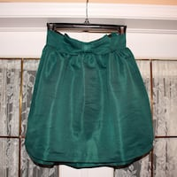 Green a-line skirt with front bow