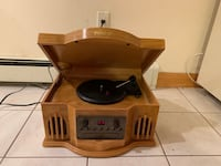 Light brown wooden philco  record player as we as a well as a cd player New York, 11105
