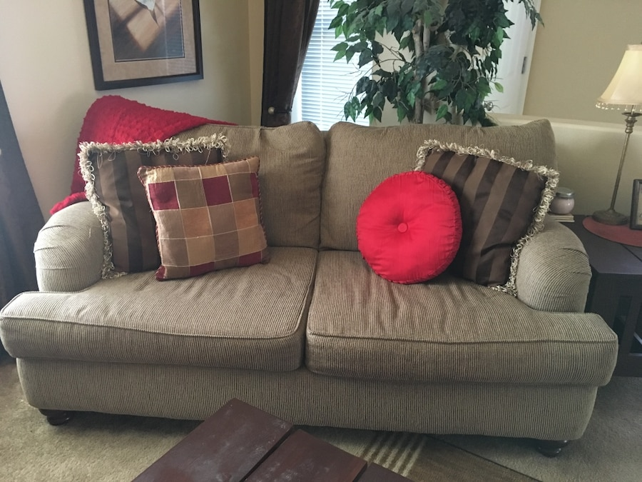 used cream with brown accents 3 seat sofa with throw pillows with matching loveseat in corvallis. Black Bedroom Furniture Sets. Home Design Ideas