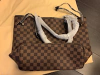 Louis Vuitton bag and pouch brand new condition. Vaughan, L4L 0G8